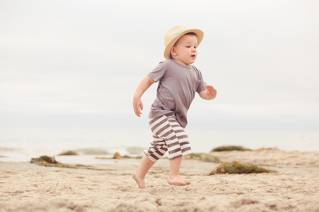 Little boy running in sand | San Diego Beach Photography