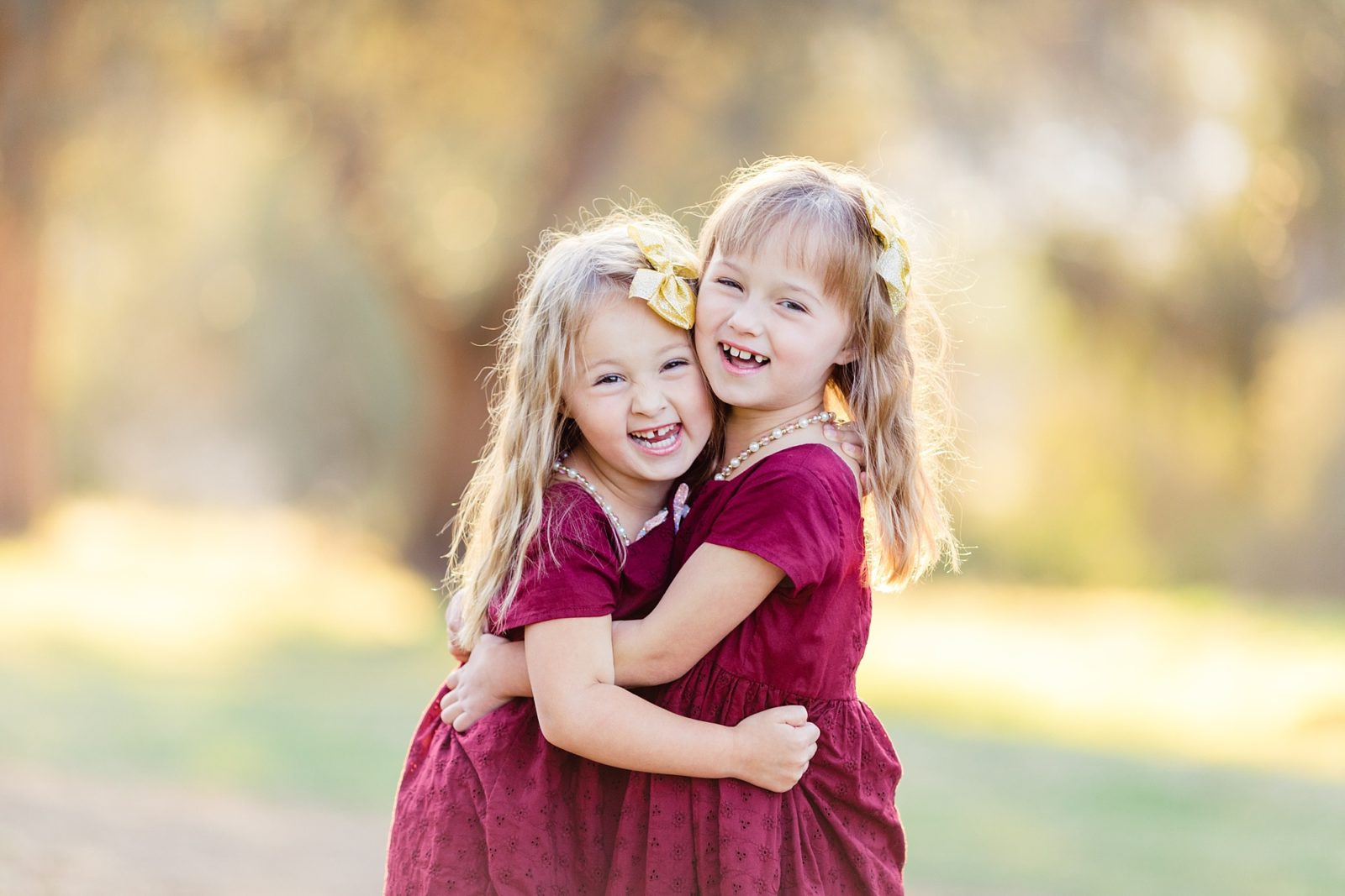 Sisters Hugging | San Diego Family Photos