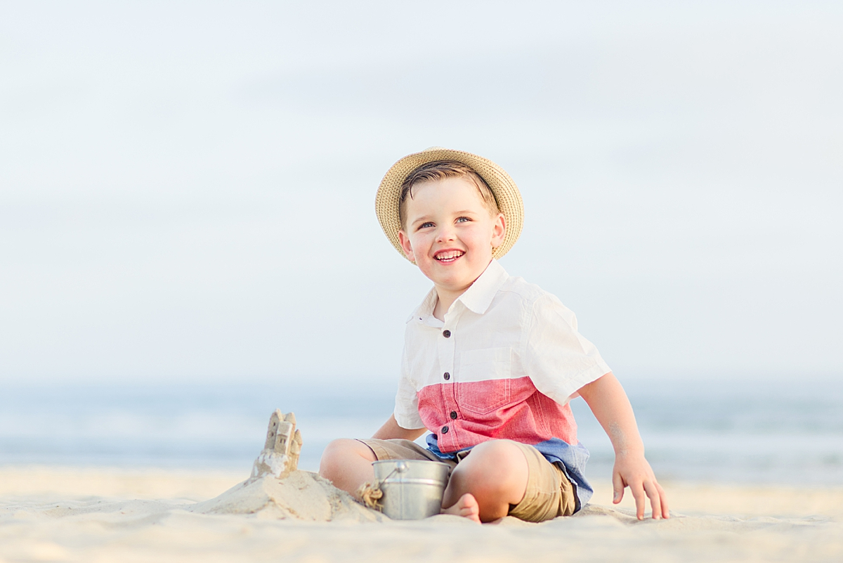 Boy in Hat Playing on the Beach