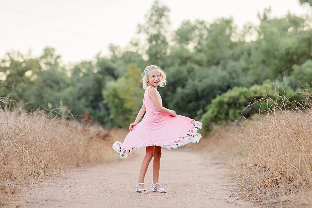 Little Girl Twirling in Field in East County San Diego