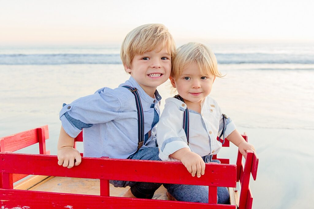Little Boys in a Christmas Wagon on the Beach