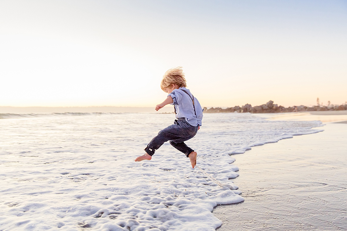 Little Boy Jumping a Wave | San Diego Photographer