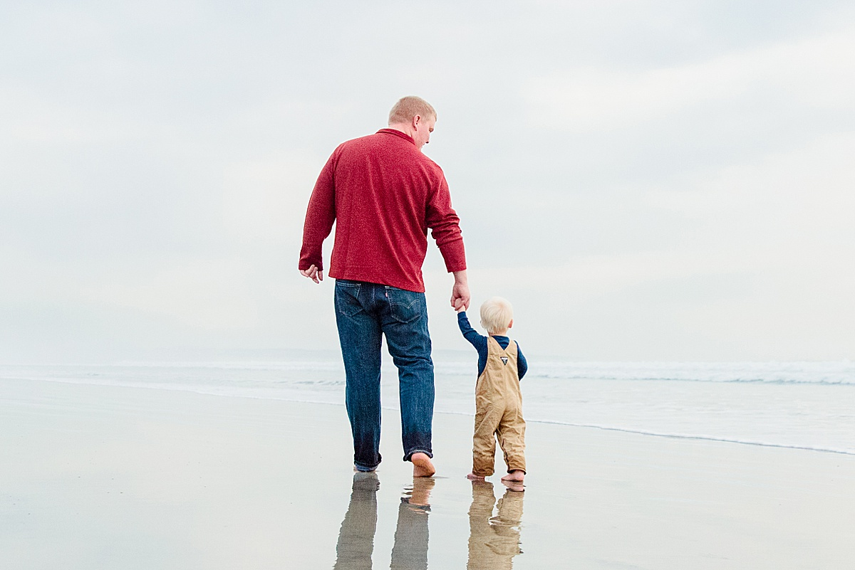 Dad and Son walking on the beach