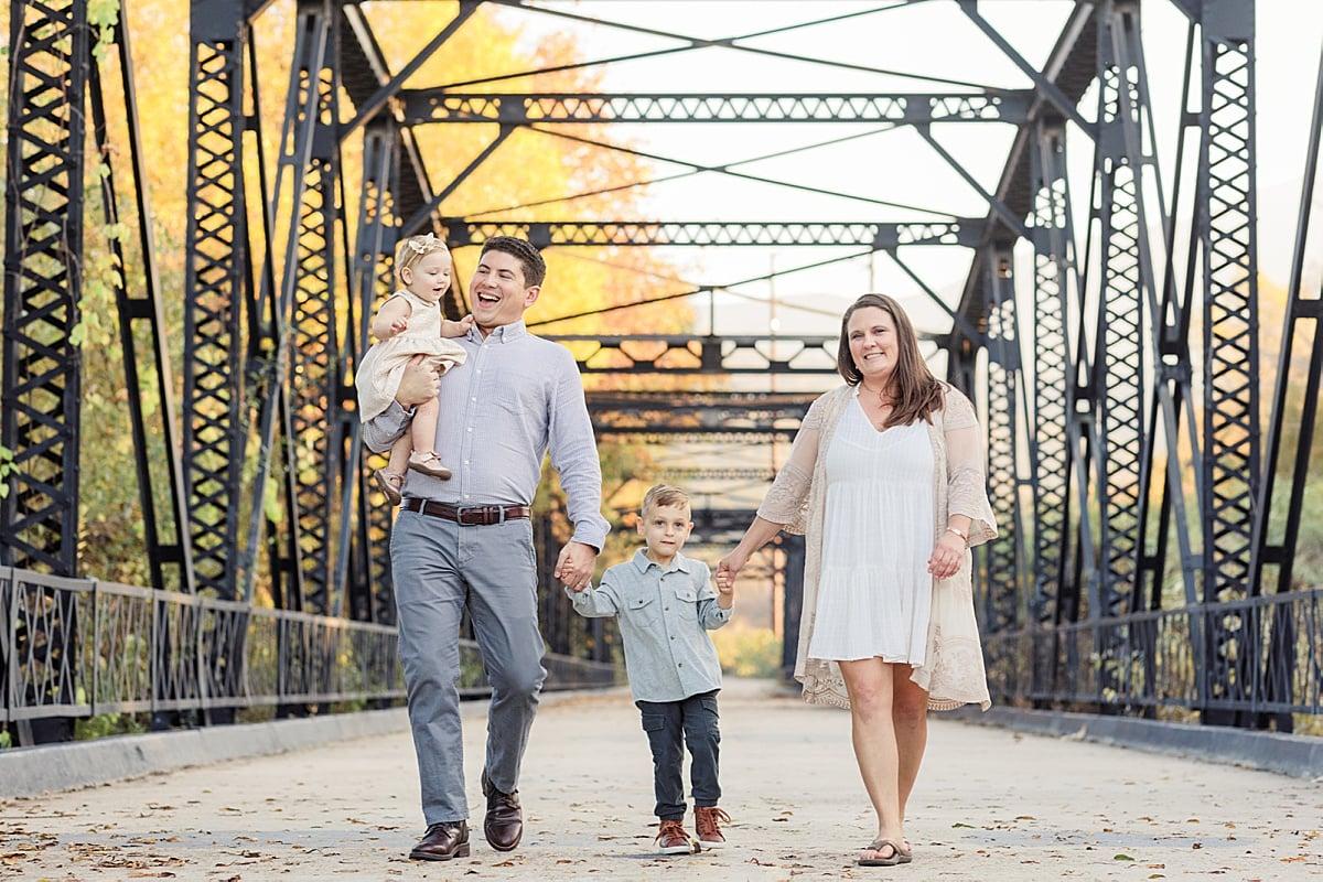 Family Walking on a Bridge