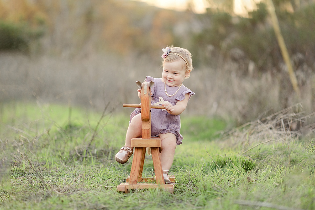 Little Girl on a Rocking Horse