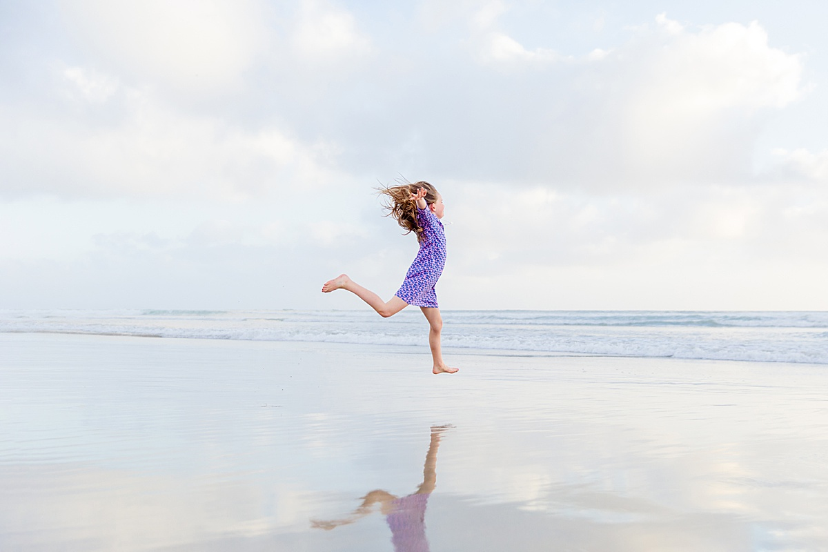 Girl Leaping on the Beach