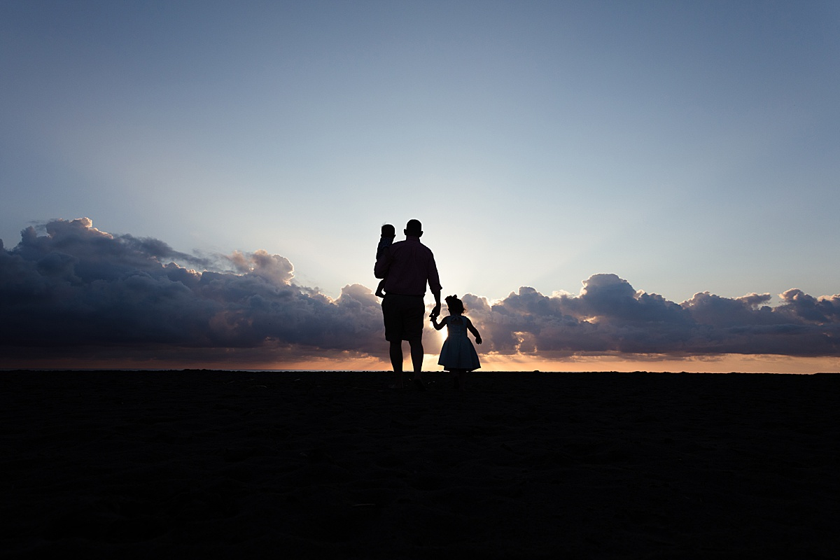 Family at Sunset on the Beach Silhouette