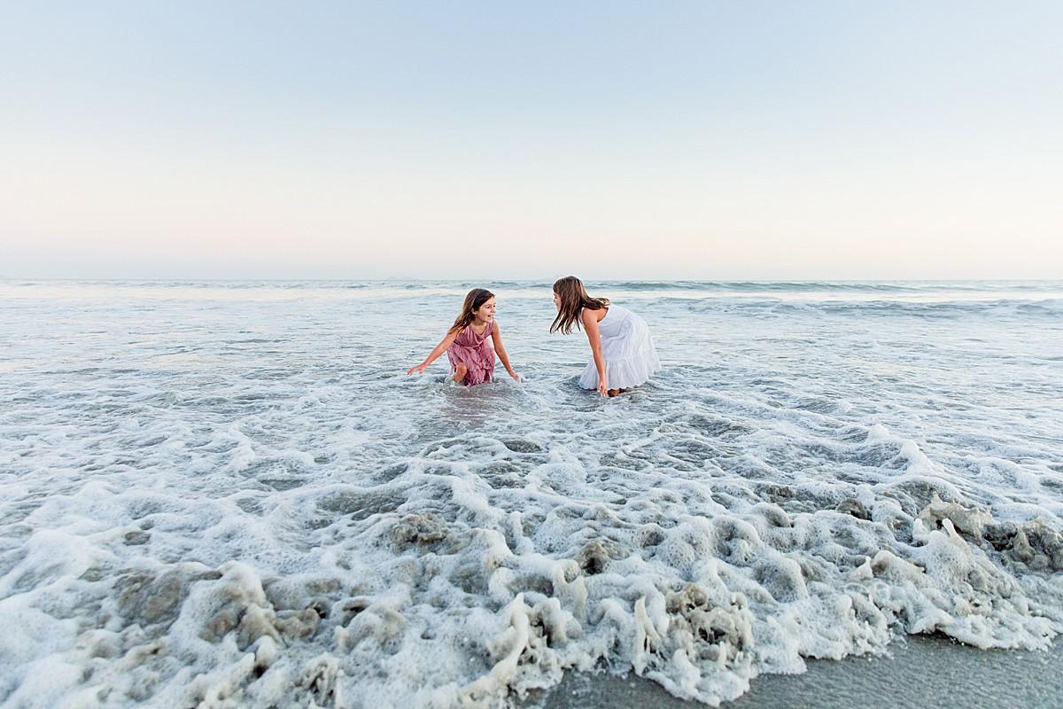 Little Girls Splashing in the Ocean