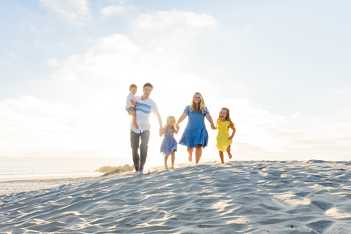 Family Running on the Beach