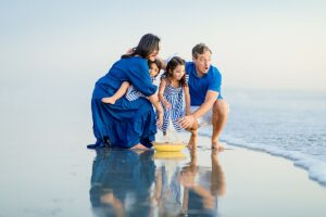 Family with Toy Sailboat