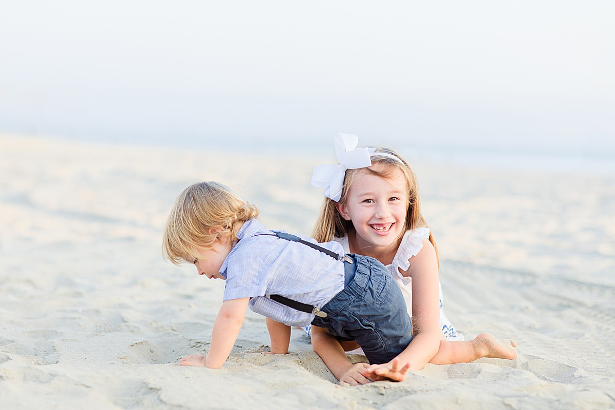 Siblings Playing on the Beach