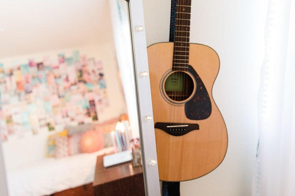 Guitar Displayed on Wall
